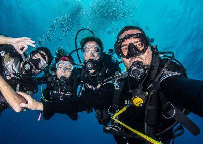 NAUI Four Divers