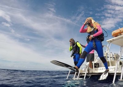Divers jumping from boat
