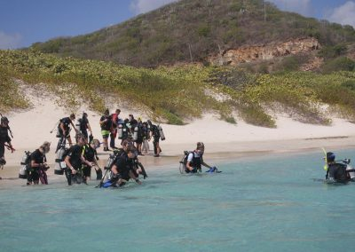 Divers on beach